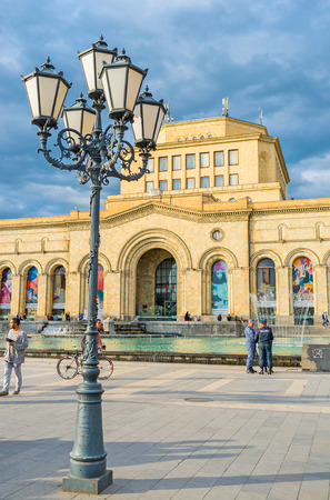 architecture monumental: YEREVAN, ARMENIA - MAY 29, 2016: The Republic Square boasts the monumental architecture, dancing fountains and scenic old style streetlights, on May 29 in Yerevan. Editorial