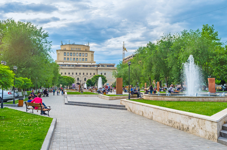 genocide: YEREVAN, ARMENIA - MAY 29, 2016: The park is occupied with exhibition, named The Cultural Genocide: symbol of Khachkars, on May 29 in Yerevan.