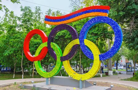olympic ring: YEREVAN, ARMENIA - MAY 29, 2016: The installation depicts the Olympic rings and the flag of Armenia, covered with bright flowers, on May 29 in Yerevan. Editorial