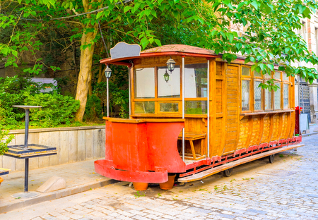 converted: The vintage tram wagon converted into cozy cafe in the old town of Tbilisi, Georgia.