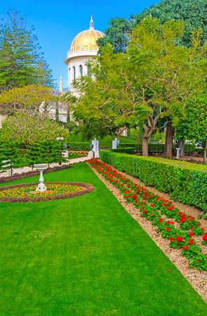 The Bahai Gardens, located on the mountain slope, devided into the different levels, separated with the gates, Haifa, Israel.