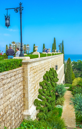 HAIFA, ISRAEL - FEBRUARY 20, 2016: The numerous tourists visit Bahai Gardens and Shrine, enjoying the perfect landsaping and nice views, on February 20 in Haifa.