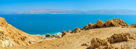 judean desert: The yellow rocks of Judean Desert with the bright blue waters of the Dead Sea on the background, Ein Gedi, Israel.
