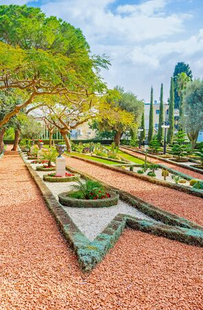 ornamental garden: The beauty of ornamental garden with gravel paths, trimmed plants and geometric flower beds, Bahai Gardens, Haifa, Israel. Stock Photo