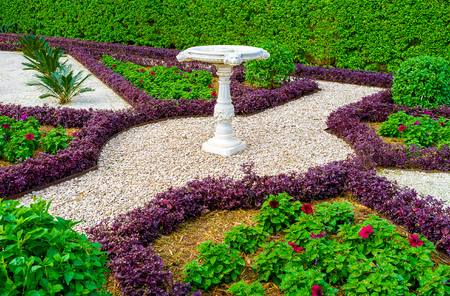 The footpaths in Bahai gardens fenced with different plant borders and covered with gravel, make nice ornaments on earth, Haifa, Israel.