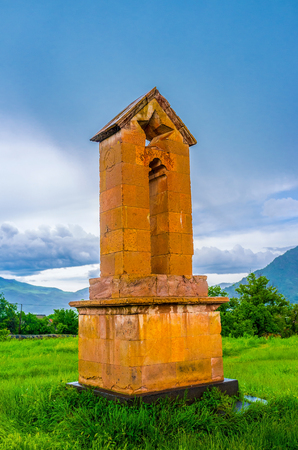 The Soviet era monument with the carved star  and relief of the Hammer and Sickle, located next to the Basilica of Odzun village, Alaverdi, Armenia.