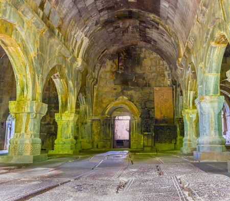 floor covering: SANAHIN, ARMENIA - MAY 30, 2016: The interior of Sanahin Monastery with the row of arched passes and medieval tombstones, covering floor, on May 30 in Sanahin. Editorial