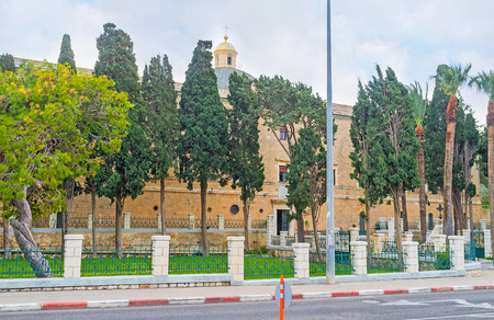 carmel: The Stella Maris Monastery, located on Mount Carmel and surrounded by green garden, Haifa, Israel. Stock Photo