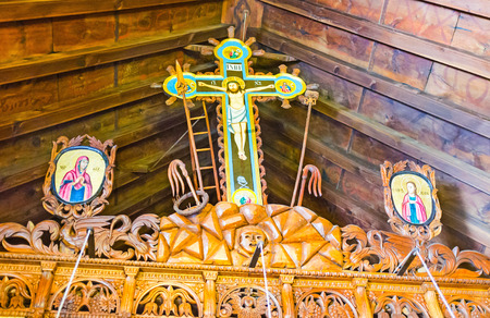 FIKARDOU, CYPRUS - AUGUST 6, 2014: The wooden iconostasis in Church of Apostles Peter and Paul decorated with carved and painted details, on August 6 in Fikardou. Editorial