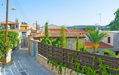 of pano: The narrow street of the traditional mountain village of Kato Drys, located next to Pano Lefkara in Larnaca Region, Cyprus. Stock Photo