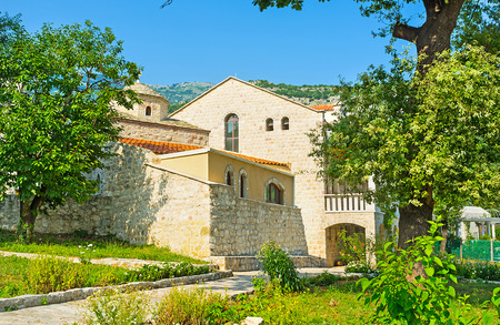 The rebuilt complex of the former monastery surrounds preserved St Petka Church in Budva, Montenegro.