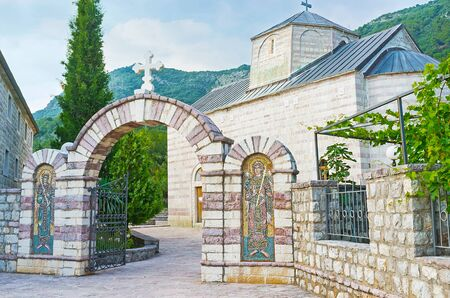 The scenic entrance to Podmaine Monastery, decorated with the mosaic icons from both sides, Budva, Montenegro. Editorial