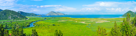 wide  wet: The wide area of the wet meadows on Skadar Lake, the view from Virpazar hill, Montenegro.