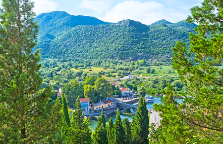 The aerial view on the roofs of Virpazar through the trees of the Castle hill, Montenegro.