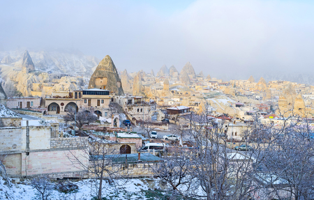 goreme: The winter morning in Goreme, full of the sharp peaked cone rock formations, Cappadocia, Turkey. Stock Photo