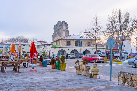 boast: ORTAHISAR, TURKEY - JANUARY 19, 2015: The small mountain resort in Cappadocia boast the high natural rock formation in the old center, that was used as the defensive fortress in the Middle Ages, on January 19 in Ortahisar. Editorial