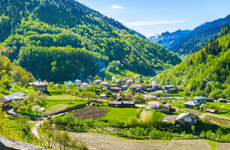 continuously: The townlet of Bogreshi, located in Enguri Valley, leading to Ushguli, one of the highest continuously inhabited settlements in Europe, Georgia. Stock Photo