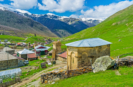 ushguli: The view from the hill on the old St George Church and preserved medieval Svan towers of Ushguli, Upper Svaneti, Georgia. Stock Photo
