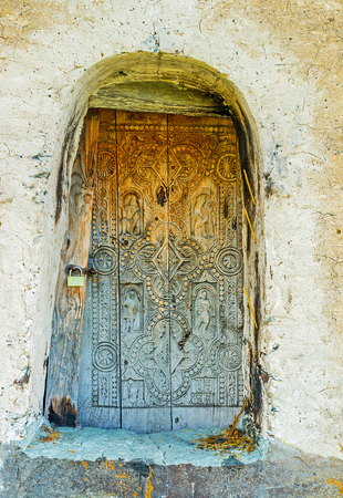 mestia: The old door of the St George church, decorated with carved patterns, Ushguli, Georgia.