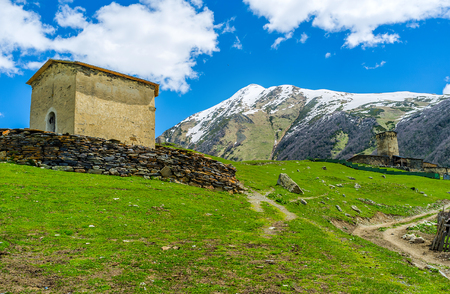 ushguli: Two old churches in Ushguli - Jgrag (St George) and Lamaria, located on the highest hill in Zhibiani village, Upper Svaneti, Georgia.