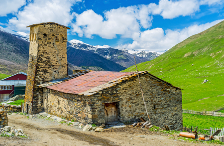 ushguli: The medieval traditional house of Svan family with the stone tower, typical for all Svan houses, Ushguli, Upper Svaneti, Georgia.