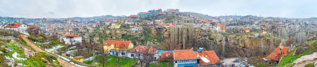 occupying: The wide panorama of Ihlara town, occupying the picturesque gorge and with the Hasan Mount on the left, Cappadocia, Turkey.