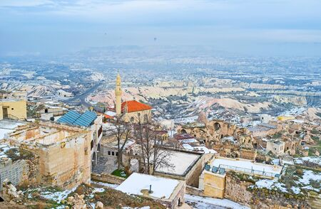 foggy hill: The view from the Uchisar Castle on the town roofs on the hill in foggy winter day, Cappadocia, Turkey. Editorial