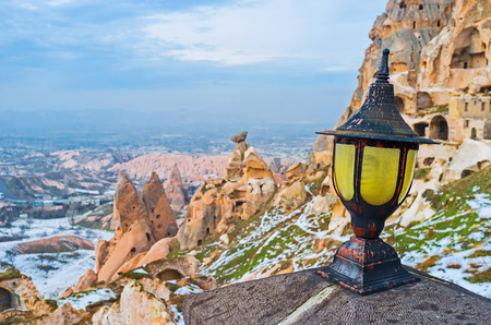 housing style: The old style lantern with the ruins of housing of Byzantine period on the background, Uchisar, Cappadocia, Turkey.