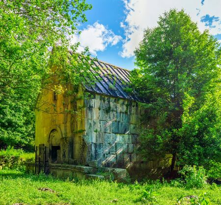 The church of the Mother of God of Jukhtak Vank Monastery is hidden behind the trees of  Dilijan National Park, Armenia.