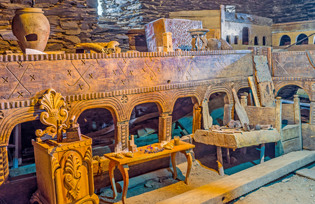 svan: USHGULI, GEORGIA - MAY 22, 2016: The carved wooden furniture in Ethnographic Museum in the medieval house of Svan family, on May 22 in Ushguli.