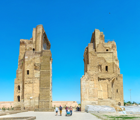 place of interest: SHAKHRISABZ, UZBEKISTAN - MAY 2, 2015: The ruins of the great portal of Ak-Saray Palace, the place of historic and tourist interest, on May 2 in Shakhrisabz.