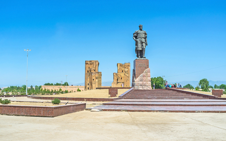 conqueror: SHAKHRISABZ, UZBEKISTAN - MAY 2, 2015: The monument to the Turco-Mongol conqueror Amir Temur in the place of his birth with the ruins of Ak-Saray Palace on the background, on May 2 in Shakhrisabz.