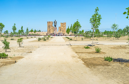 The street leads to Amir Timurs monument and ruins of Ak-Saray Palace on the background, Shakhrisabz, Uzbekistan.