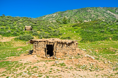 foothill: The ramshackle shed, built of stone and clay, located on the foothill of Samak kishlak (village), Uzbekistan.