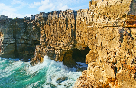 jaws: The cave in coastal rocks of Cascais is famous as the Boca do Inferno (The Jaws of Hell) or the Devils Cave, Portugal. Stock Photo