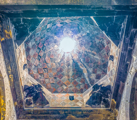 HAYRAVANK, ARMENIA - MAY 31, 2016: The cupola in Church of Hayravank Monastery decorated with stone mosaic and carvings, on May 31 in Hayravank. Editorial