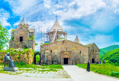 gosh: GOSH, ARMENIA - MAY 31, 2016: The churches and chapels of Goshavank Monastery, located on the hill and surrounded by green mountains, on May 31 in Gosh.