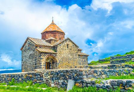 The St Astvatsatsin Church of Sevanavank Monastery, neighbors with the medieval cemetery on Sevan Peninsula, Armenia. Stock Photo