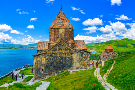 SEVAN, ARMENIA - MAY 31, 2016: The tourists visit Sevanavank Monastery, located on Sevan Peninsula, among the bright green hills, on May 31 in Sevan Stockfoto