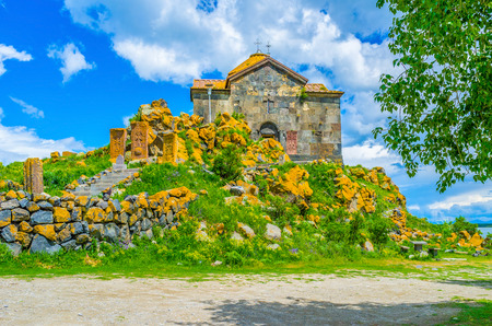 Armenia is famous for its medieval stone Orthodox Monasteries and khachkars cross-stones, The Hayravank Monastery, located on the hilly bank of Sevan Lake. Stock Photo