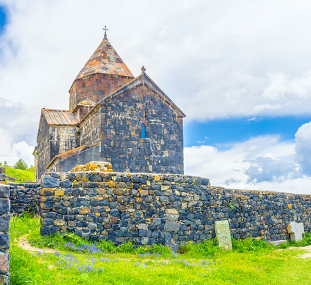 The massive stone fence in front of Surp Arakelots (Holy Apostles) Church of Sevanavank Monastery, Sevan, Armenia.