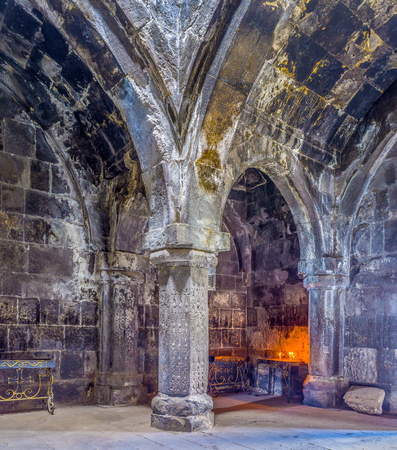 frontage: HAYRAVANK, ARMENIA - MAY 31, 2016: The dark stone gavit (frontage hall) in Church of Hayravank Monastery is supported by columns, on May 31 in Hayravank.