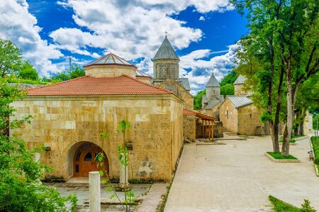 The renovated buildings of Haghartsin Monastery - Refectory and three churches on the background, Armenia. Stock Photo