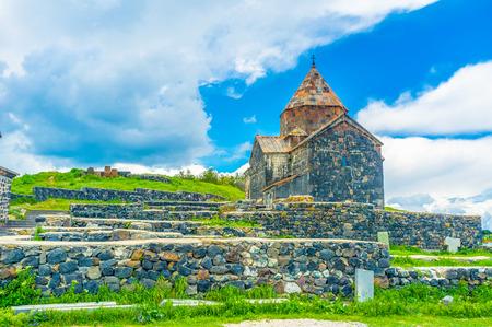 The black stone Surp Arakelots (Holy Apostles) Church of Sevanavank Monastery, located on Sevan Peninsula, Armenia.