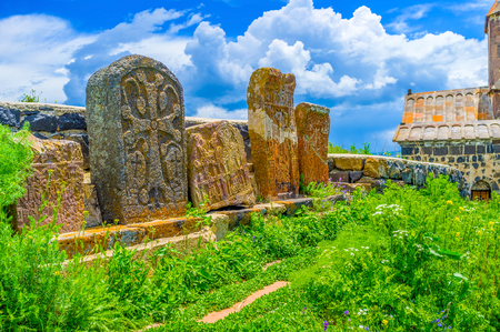 The preserved khachkars on the medieval cemetery between the churches of Sevanavank Monastery, Sevan, Armenia. Stock Photo