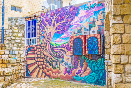 SAFED, ISRAEL - FEBRUARY 22, 2016: The colorful graffiti in branch of Gallery street depicts Safed, situated on the slope and surrounded by gardens,and the Rabbi, praying in this Holy City, on February 22 in Safed. Editorial