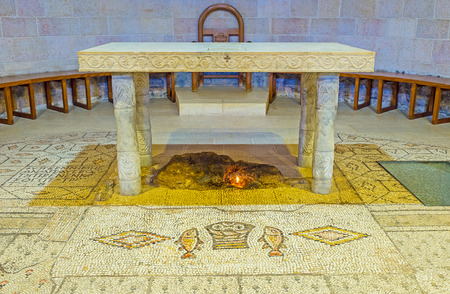 miraculous: TABGHA, ISRAEL - FEBRUARY 22, 2016: The stone Altar of the Multiplication Church, with the block of limestone, on which miraculous fish and loaves were laid, according to christian believes, on February 22 in Tabgha.