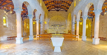TABGHA, ISRAEL - FEBRUARY 22, 2016: The prayer hall of Multiplication Church has a central nave and two aisles, its decorated with restored mosaic floor, on February 22 in Tabgha.