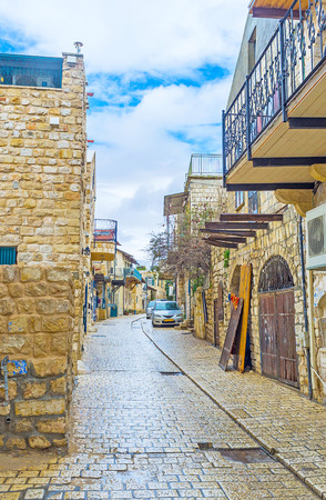 The old town of Safed looks clean and empty after the hard rain, the wet paving shines in the sunlight, Israel. Editorial