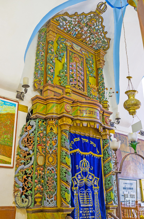 ashkenazi: SAFED, ISRAEL - FEBRUARY 22, 2016: The Torah Arc in Ari Ashkenazi Synagogue, made of the olive wood and decorated with colorful carved patterns, on February 22 in Safed. Editorial